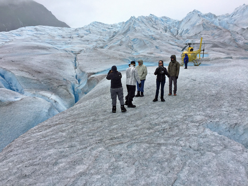 How do you walk around the otherworldly terrain of a glacier? Very carefully! (Boots with good grips provided by tour operator)
