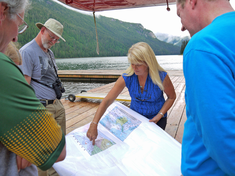 During a pit stop, Michelle orients visitors to the vast southeast Alaskan Misty Fjord park