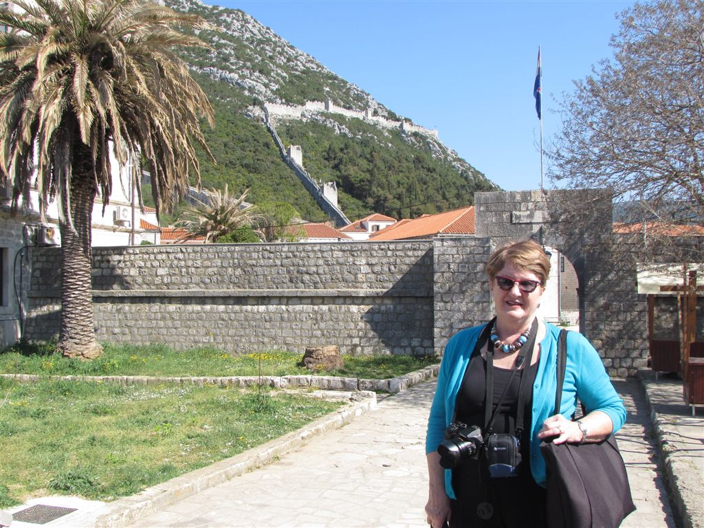 Author in front of Europe's longest stone wall in Ston, Croatia