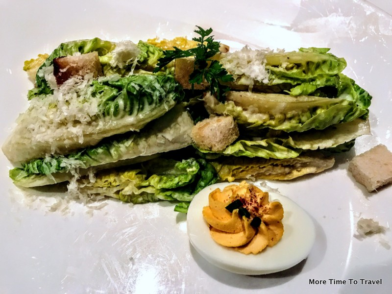 Gotham Caesar Salad with romaine, white anchovies, parmesan and deviled egg