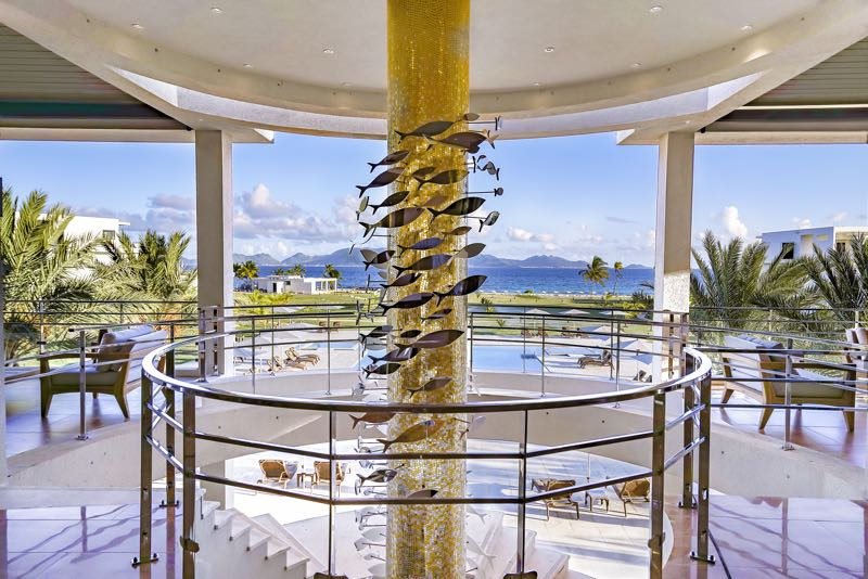 Glittering lobby at The Reef by CuisinArt offers a view of the grounds, the pool and, in the distance, the beach (Credit: The Reefs)