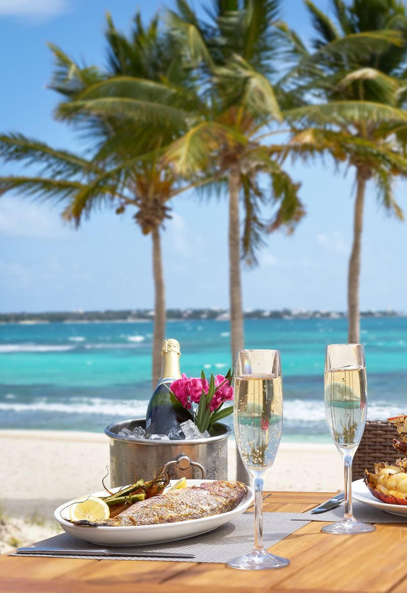 The Breezes restaurant at the Reef by Cuisinart opens directly onto the beach (Credit: The Reef)