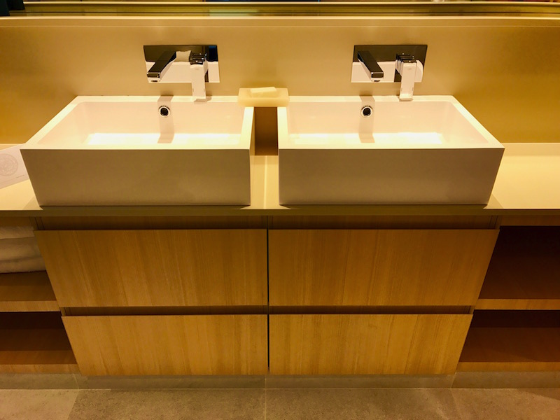 Convenient His & Her Double-Sinks with plenty of space to stow toiletries