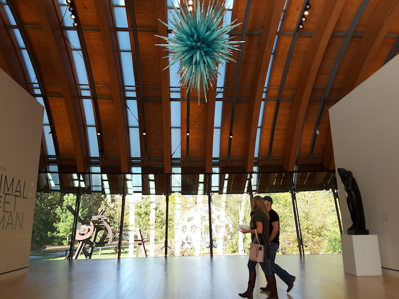 Massive windows at Crystal Bridges serve as the background for the art