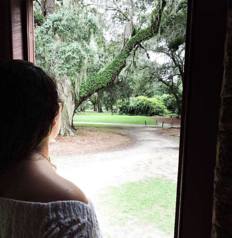 Author looking out of one of the slave cabins