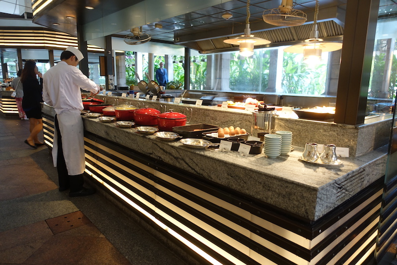 Breakfast station with hot entrees at Peninsula Bangkok