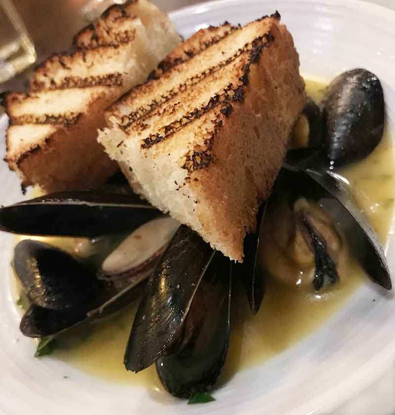Penn Cove mussels, served Sicilian style (© Debbra Dunning Brouillette)