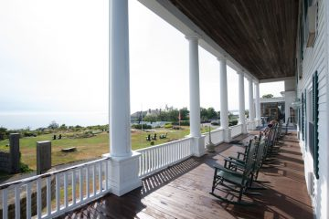 It's hard to resist settling into the rocking chairs on the Emerson Inn's front porch and gazing over the pool and lawn to the sea.