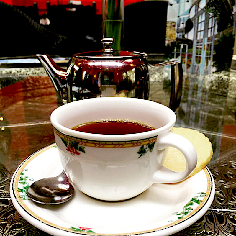 A restorative cup of tea in the Garden Bar was the ideal cure for jet lag (Credit: Laura Paquet)
