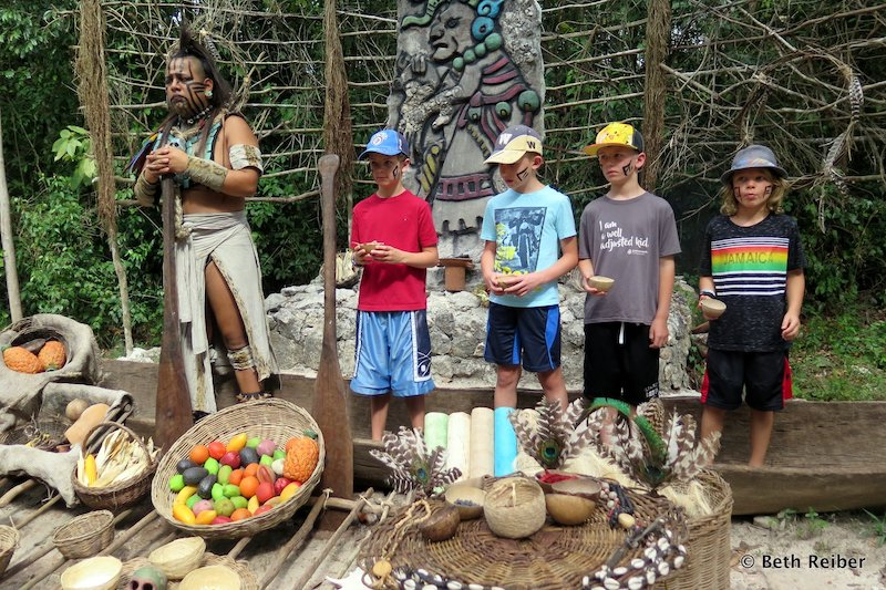 A group of young visitors make offerings to Ixchel at Pueblo del Maiz