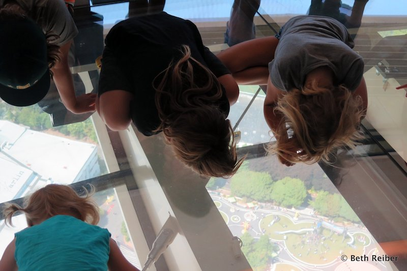 Children peer at the ground below in the Space Needle (Credit: Beth Reiber)