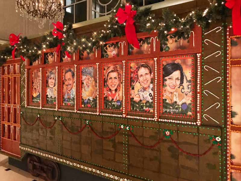 Life-size gingerbread replica of St. Charles Avenue Streetcar with New Orleans legends peeking through windows (Photo credit: New Orleans Ritz-Carlton Hotel)