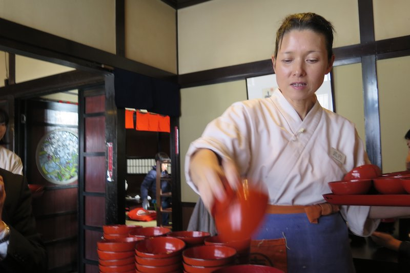 Waitress at a wanko soba restaurant serves bowls of noodles one after another until you give the special signal to stop