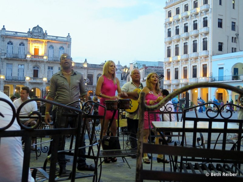 Best experiences in Havana: Many restaurants on Plaza Vieja have outdoor seating and musicians