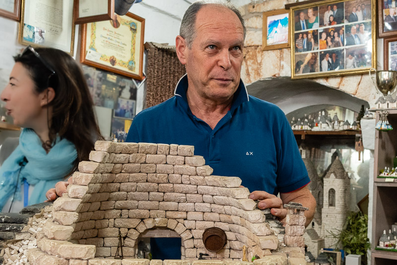 Guiseppe Maffai, architect and Cavaliere, explains the construction of trulli in Alberobello