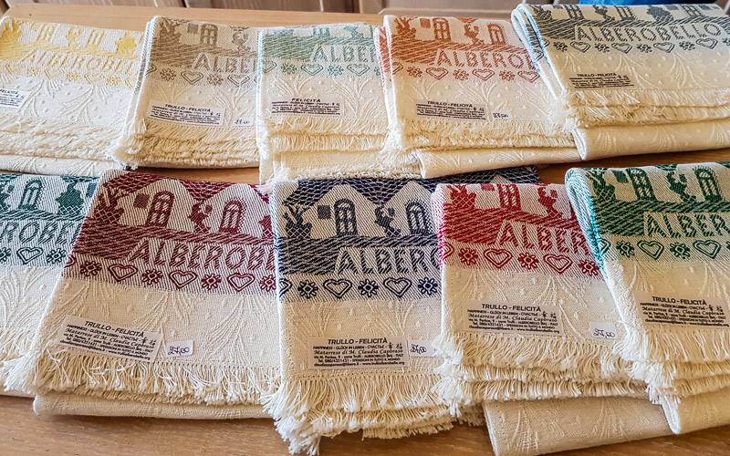 Towels with needlework using natural dyes