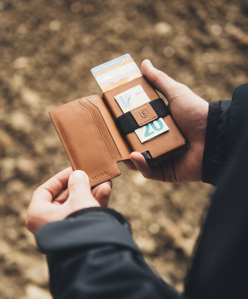 The inside of the smart travel wallet has an elastic strap and two ID card slots