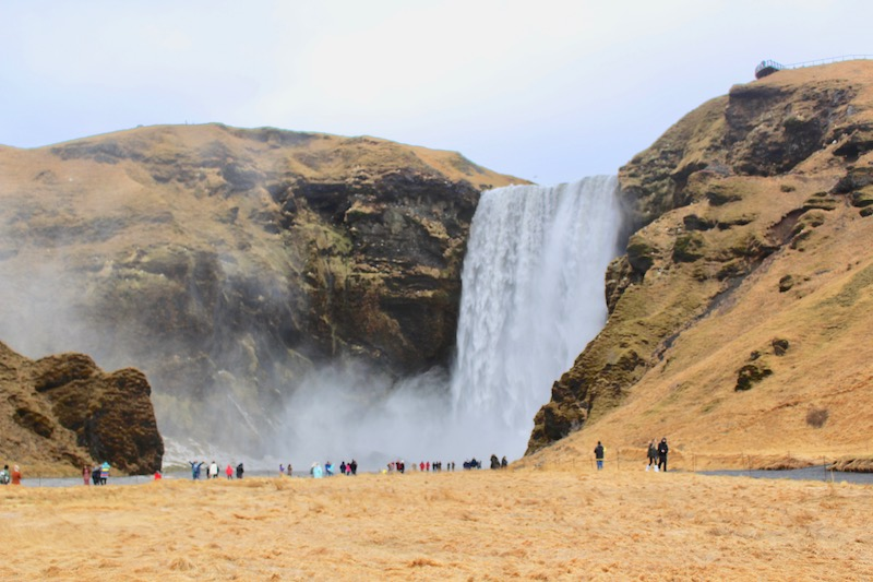 The enormous Skogafoss creates a huge cloud of mist
