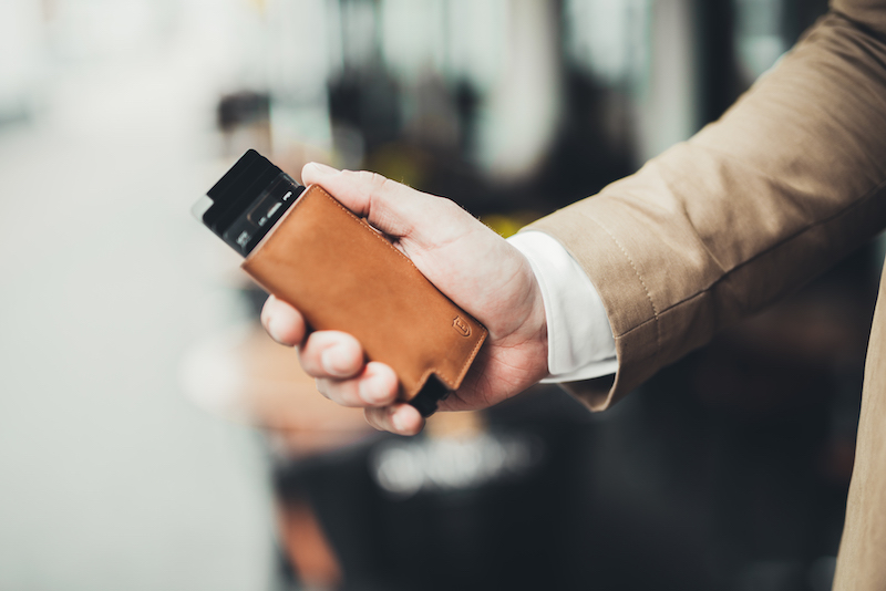 The Ekster Smart Travel Wallet easily fits in the palm of one's hand