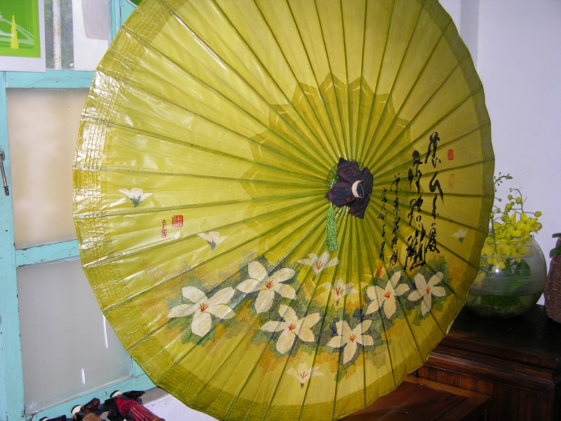 The perfect memento: A hand-painted paper umbrella