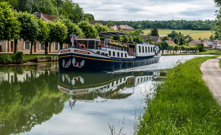 the European Waterways' barge La Belle Epoque cruises down the Burgundy canal in France
