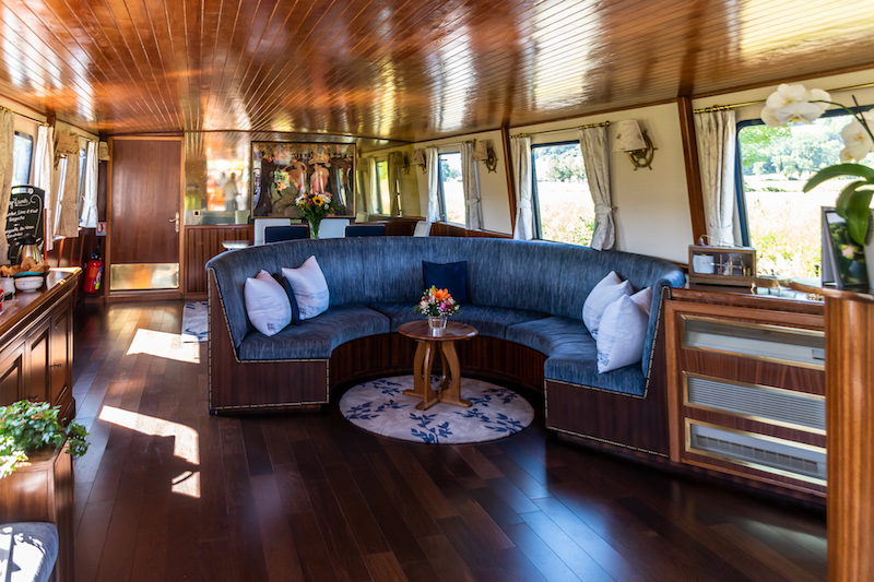 The cabin of the La Belle Epoque on our canal barge cruise gleams with burnished mahogany