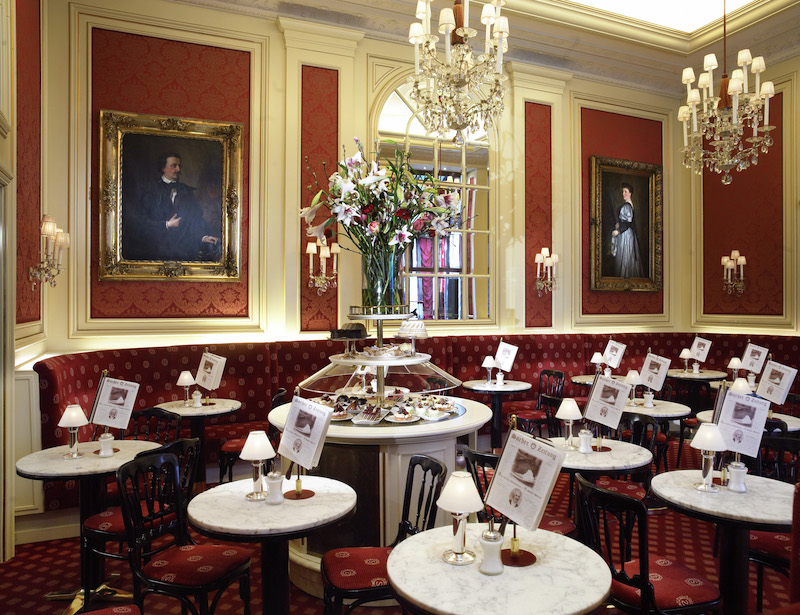A center of coffee house culture, Café Sacher, in the heart of Vienna, is the quintessential Viennese coffeehouse with ornately decorated walls, classic portraits and glittering chandeliers. Courtesy Hotel Sacher.