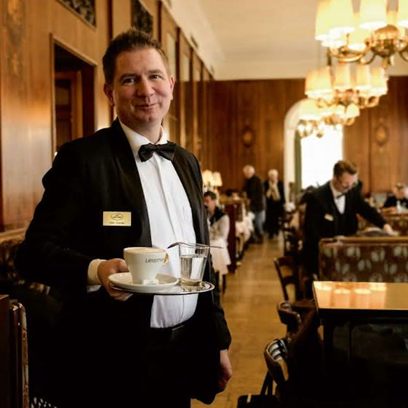 Waiters in Vienna coffeehouses are, by tradition, addressed as Herr Ober, such as this formally attired server in Café Landtmann, which has been serving up coffee and sweets since 1873.