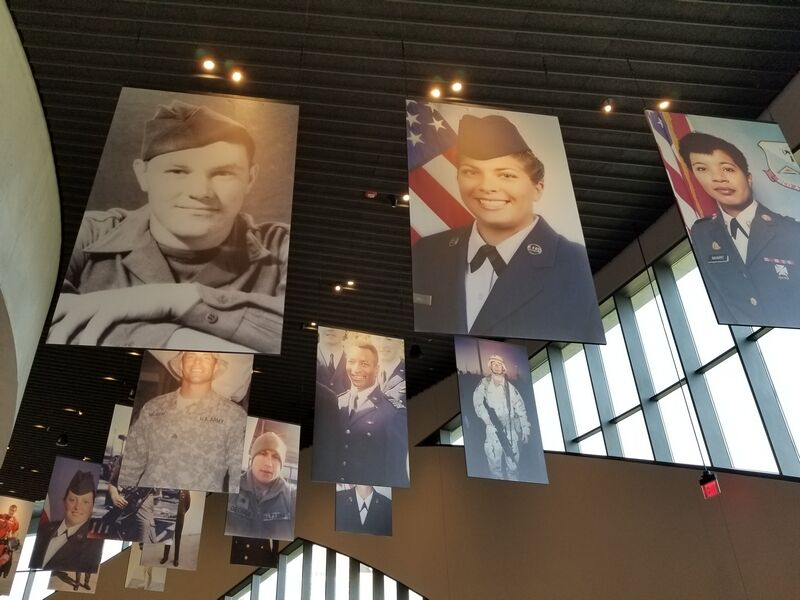 National Veterans Memorial: Individual profiles of those who served hang from above