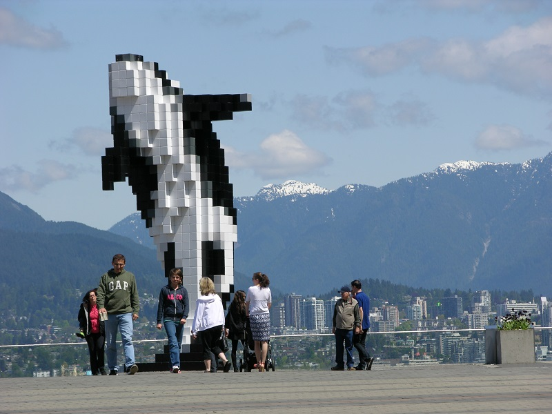 Alaska Cruise Tips: A Digital Orca appears to leap in the air on Vancouver's waterfront.