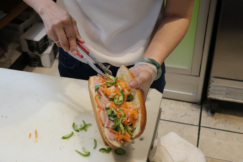 Preparing a Vietnamese sandwich at Miki Vietnamese