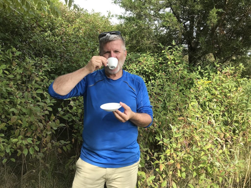 Author enjoying a heady brew of java from the best portable espresso maker while hiking Hadrian's Wall Path in Northern England