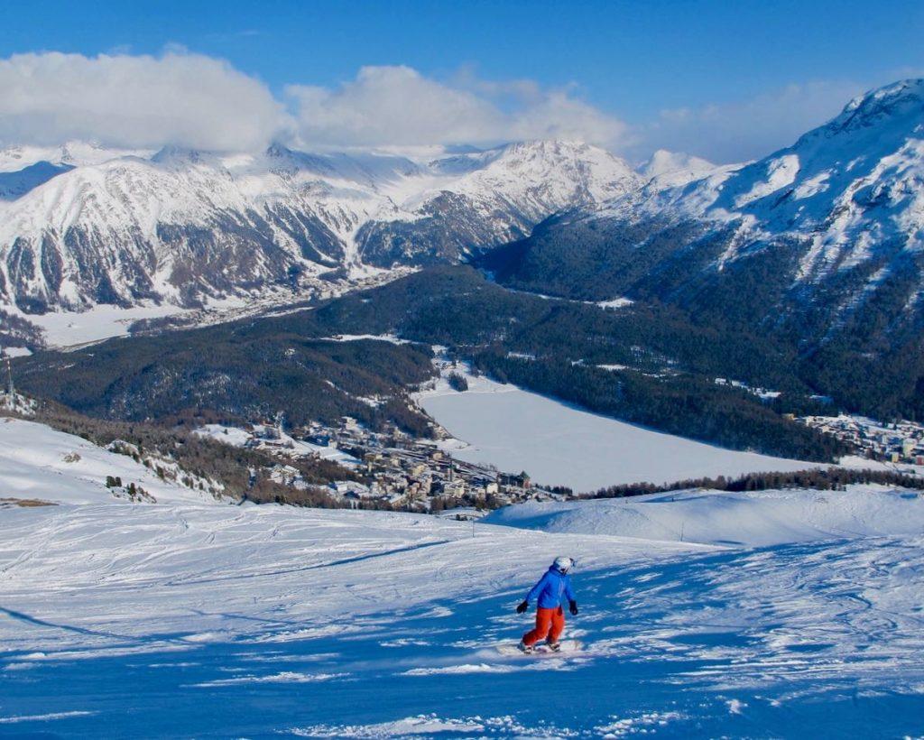 snowboarder on Corviglia alpine area in St. Moritz