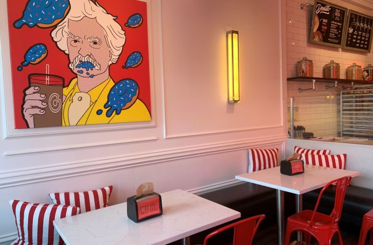 Artistic rendering of author Mark Twain surrounded by floating donuts at Donut Crazy donut shop in West Hartford, CT.