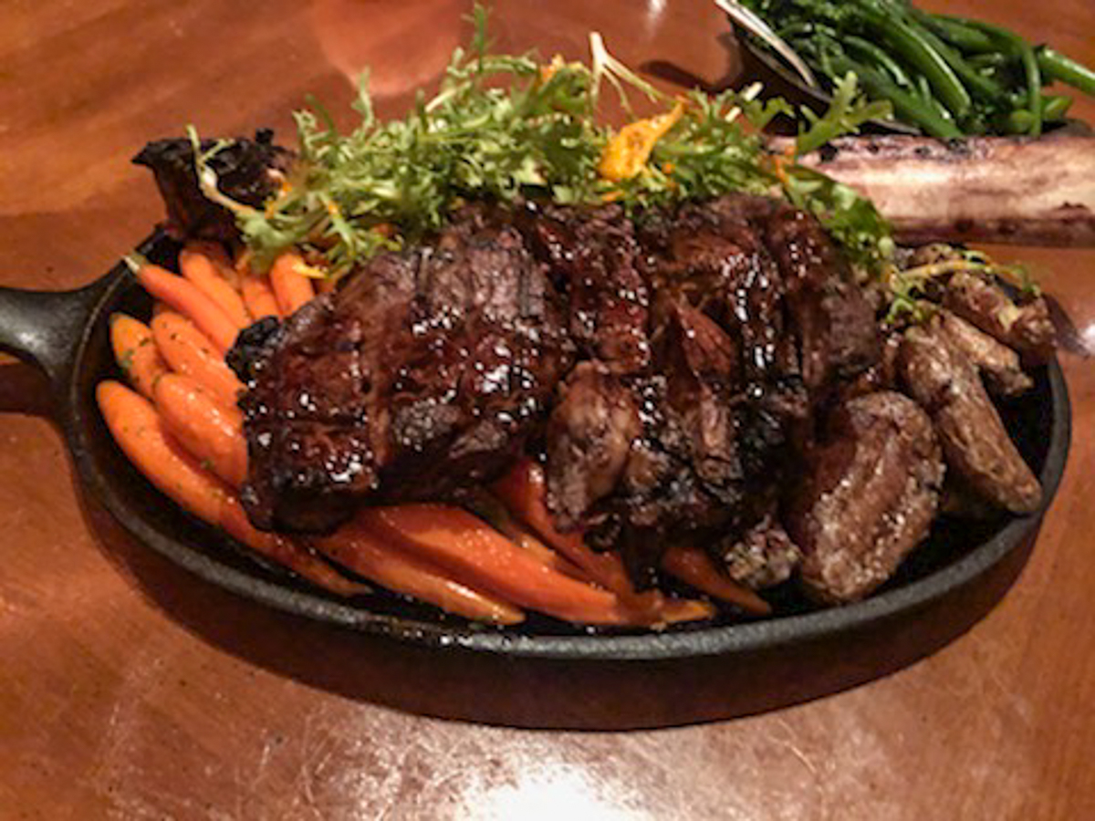 New York strip steak with roasted carrots at Amaya