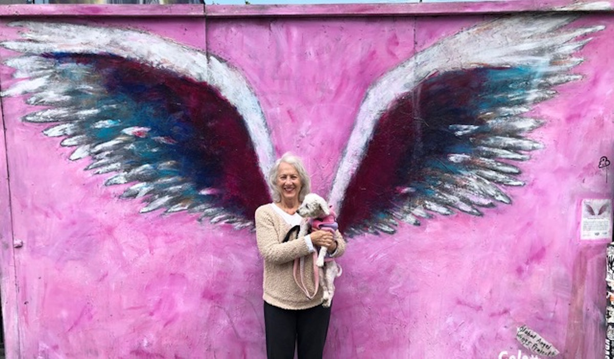 Susan of St. Louis at the iconic angel wings on Melrose), just after adopting Moxie
