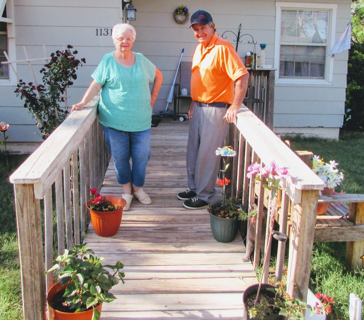 James and Betty on porch of small home in Munday.