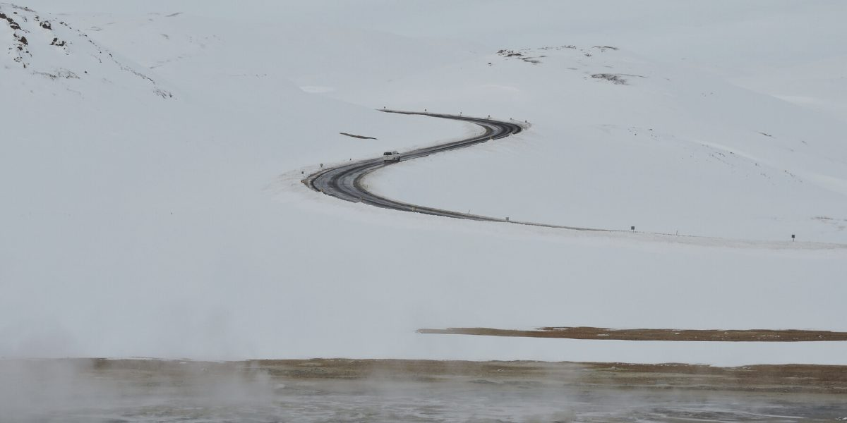 Road in Mývatn, Iceland with glimpse of the Hverir geothermal area on bottom (credit: Sheila Berrios-Nazario)
