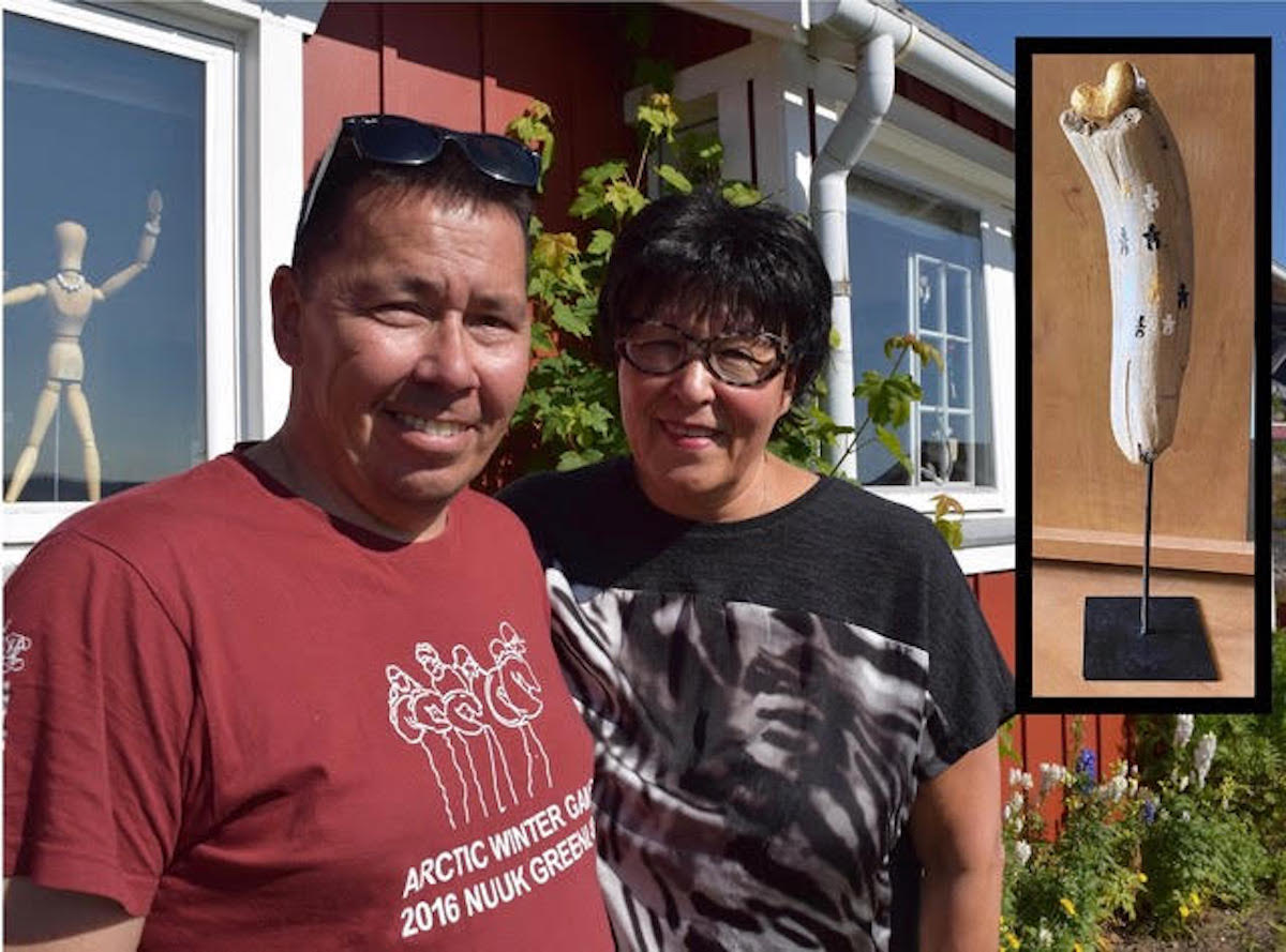 New Greenland friends outside their bright Qaqortoq home. Inset: Our treasured piece of local art