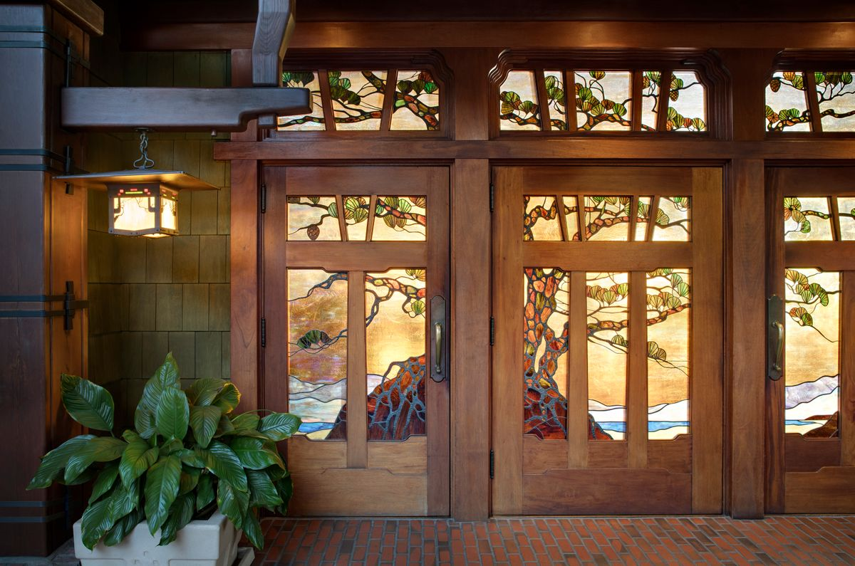 Wooden and stained-glass entrance (credit: The Lodge at Torrey.Pines)