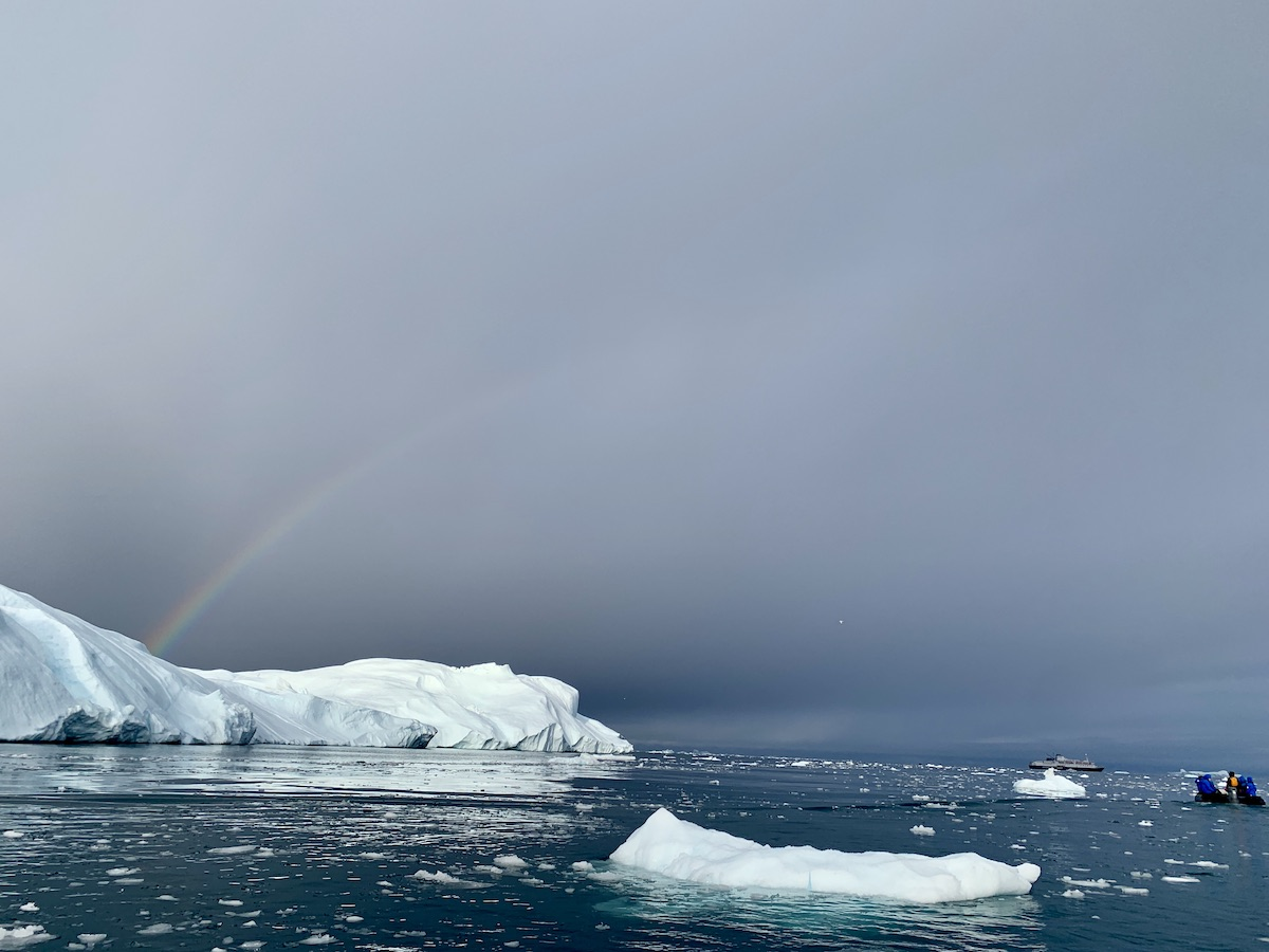 Rainbow over an iceberg in Greenland