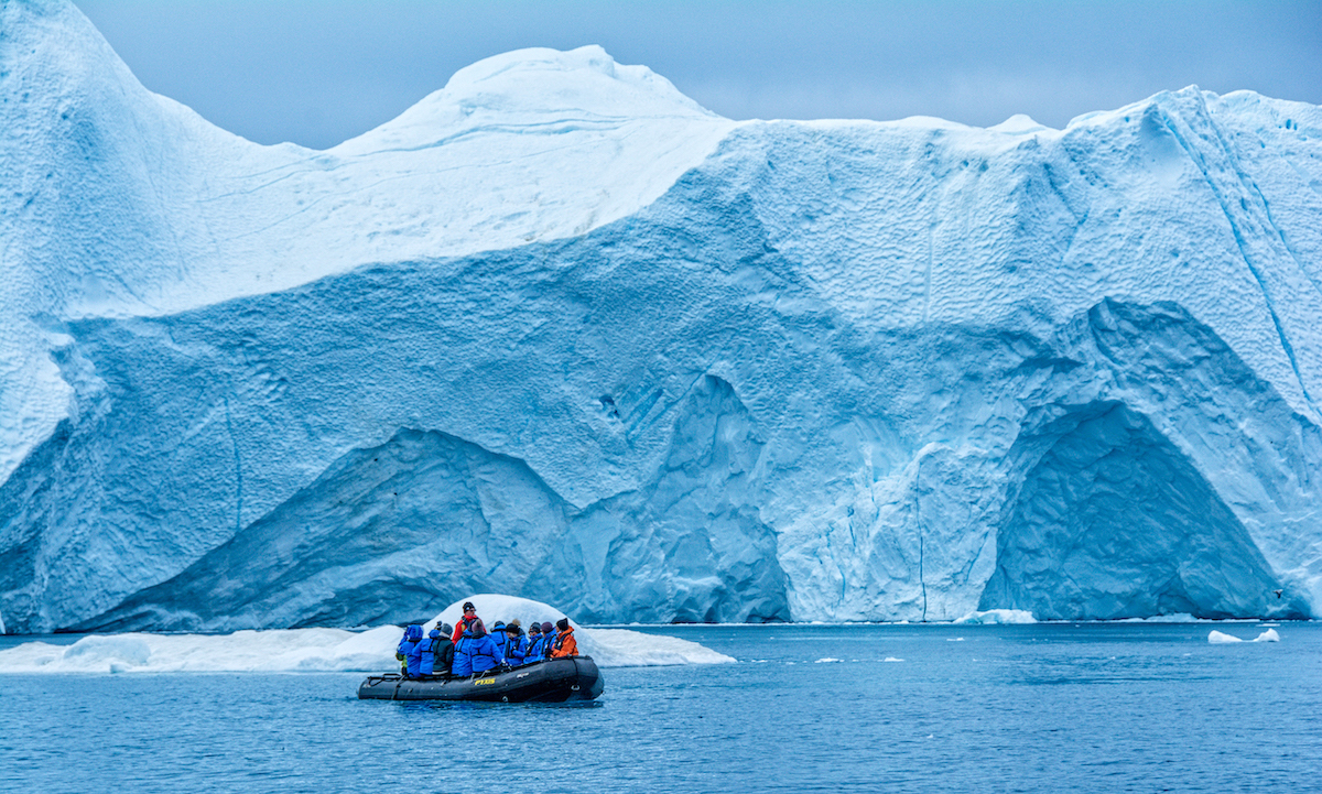 A Zodiac raft helps get close to icebergs when you  explore Greenland