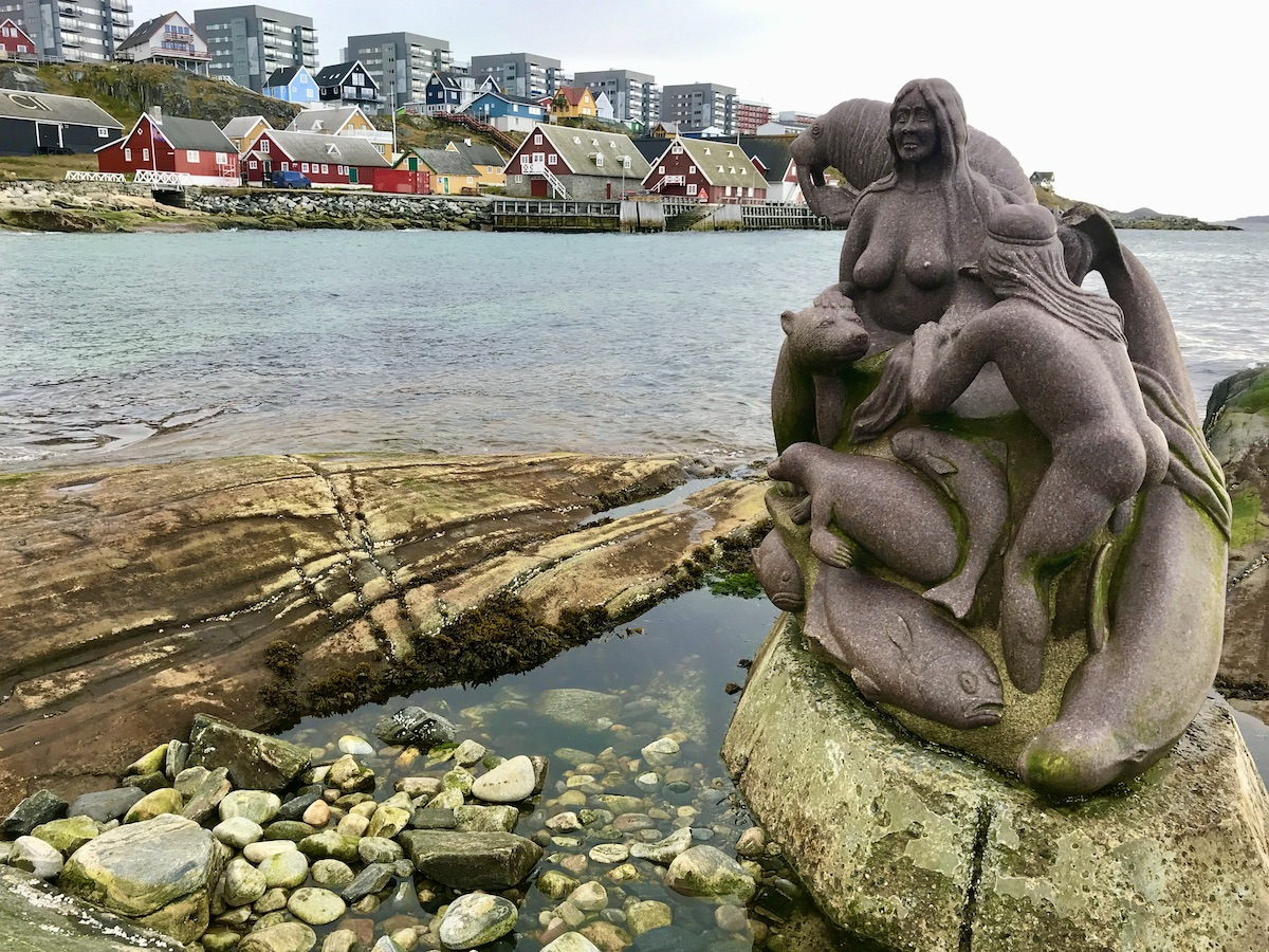 The Mother of the Sea statue in the colonial harbour at Nuuk