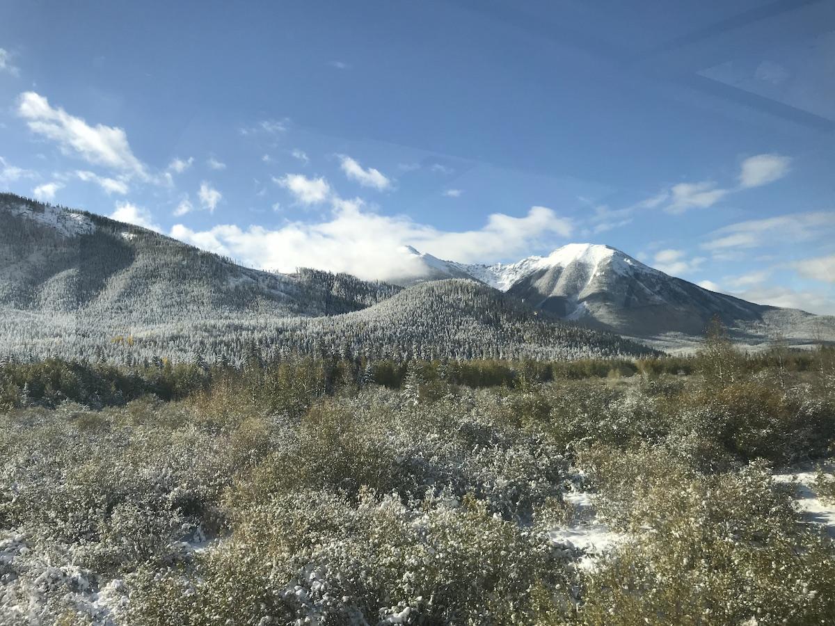 Snow-kissed Rocky Mountains as seen through the train window (credit: Jennifer Bain)
