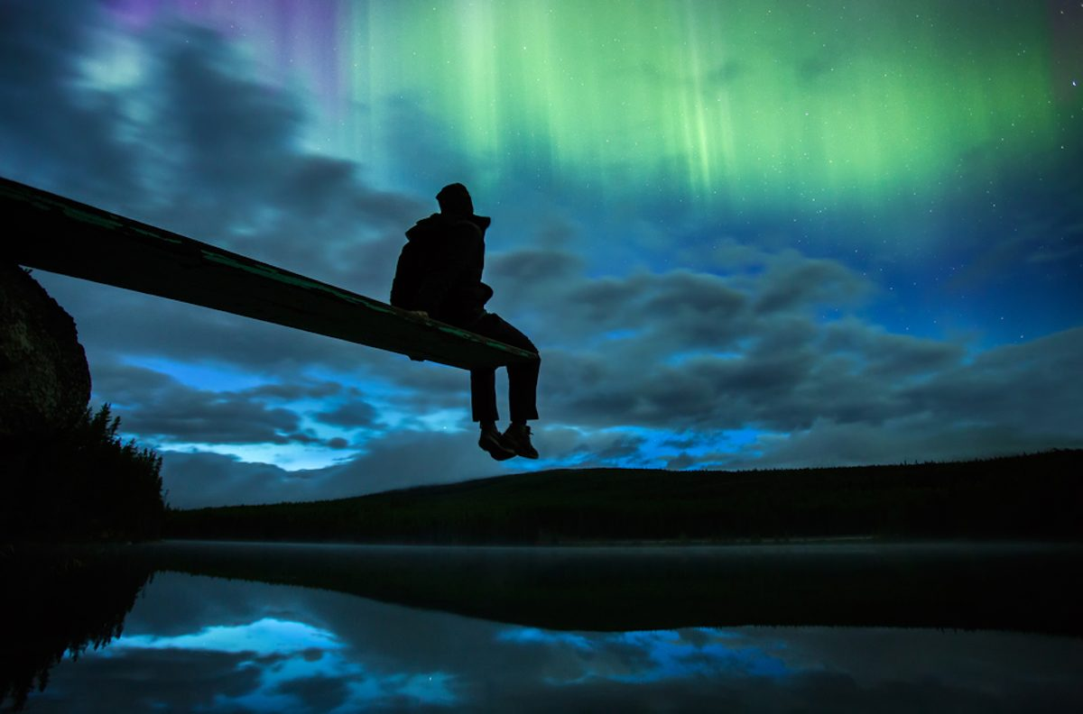 Marvelling at the aurora borealis in Banff National Park (credit: Travel Alberta)