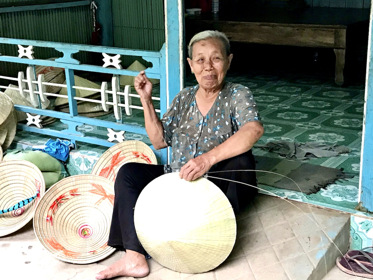One of my most memorable travel moments was meeting Miss Ba, a conical haymaker in a small village along the Mekong River in Vietnam (credit: Gwen Pratesi)