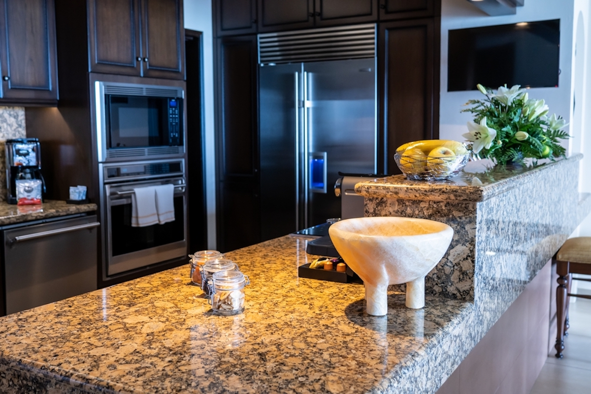 Gourmet kitchen with top shelf appliances and granite countertop