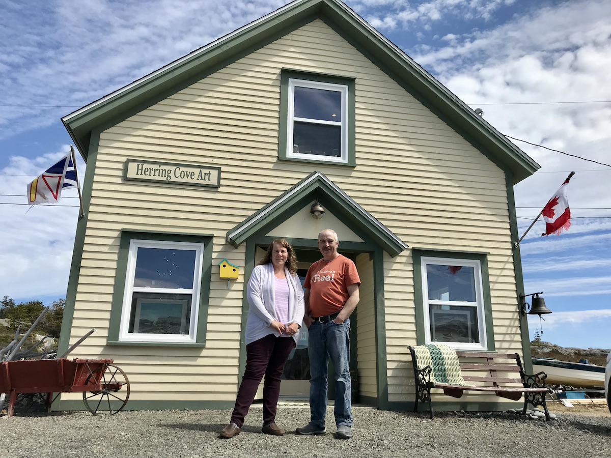 Linda and Winston Osmond in front of Herring Cove Art Gallery and Studio in Shoal Bay