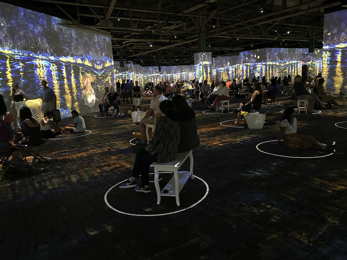 Socially distanced seating at Immersive van Gogh Charlotte