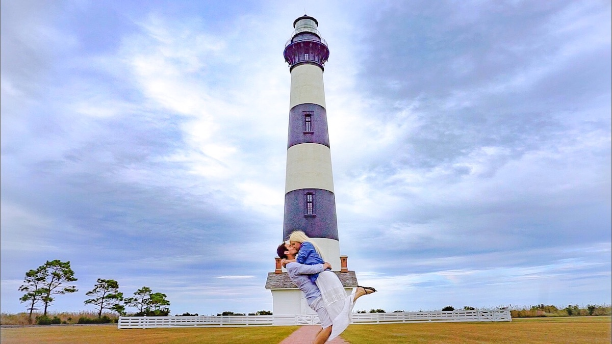 Young couple in front of one of the lighthouses at North Carolina Outer Banks